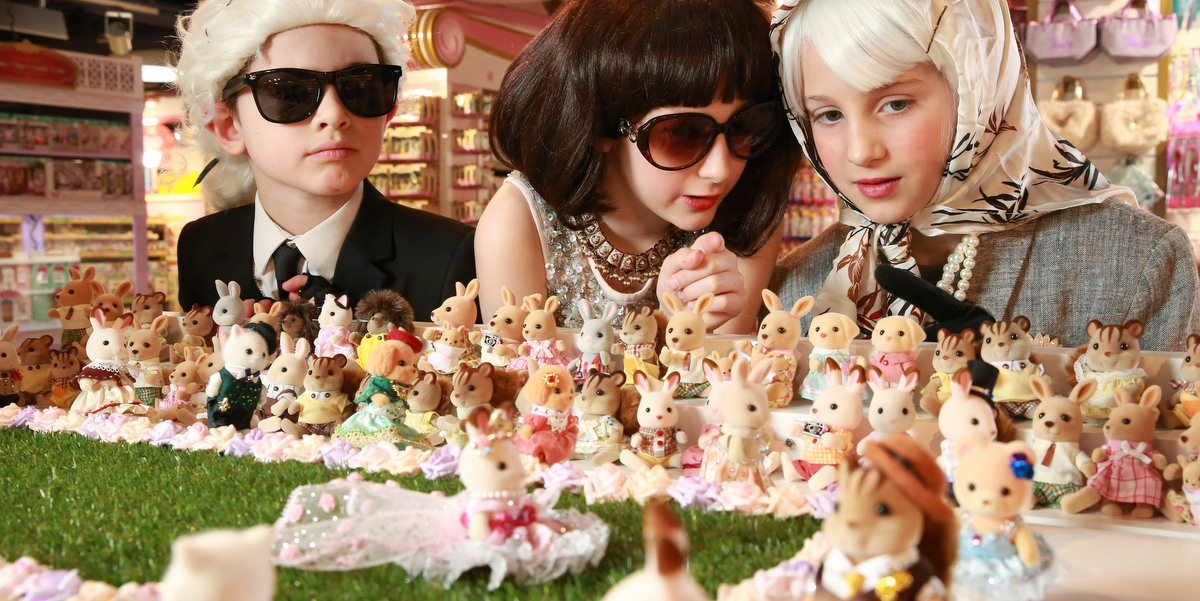 EDITORIAL USE ONLY: L-R - Rufus Rumford, aged 8, dressed as Karl Lagerfeld, Connie Davies, aged 10 dressed as Anna Wintour and Chloe Sweeting, aged 9, dressed as The Queen, on the front row at the opening of the worldÕs smallest fashion show. The event was to celebrate the launch of the new Sylvanian Families Town at Hamleys Regent Street in London. PRESS ASSOCIATION Photo. Picture date: Thursday March 22, 2018. Photo credit should read: Matt Alexander/PA Wire