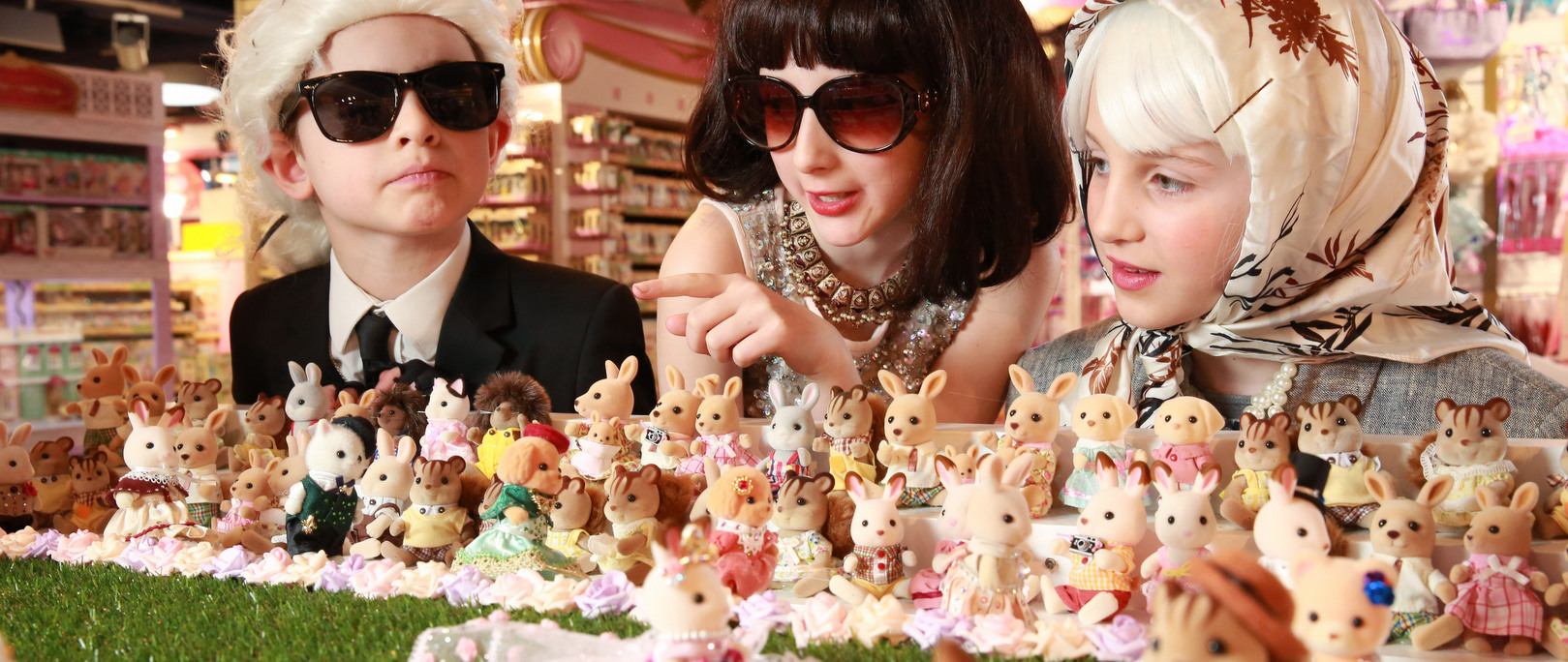 EDITORIAL USE ONLY L-R - Rufus Rumford, aged 8, dressed as Karl Lagerfeld, Connie Davies, aged 10 dressed as Anna Wintour and Chloe Sweeting, aged 9, dressed as The Queen, on the front row at the opening of the worldÕs smallest fashion show. The event was to celebrate the launch of the new Sylvanian Families Town at Hamleys Regent Street in London. PRESS ASSOCIATION Photo. Picture date: Thursday March 22, 2018. Photo credit should read: Matt Alexander/PA Wire